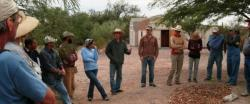 Participants review hands-on steps following greywater install.