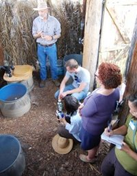 David Omick instructs soil steward participants on the proper installation and use of a barrel-style composting toilet system.