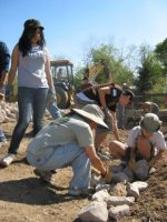 Volunteers laying rock for reducing sediment flowing into Santa Cruz River.