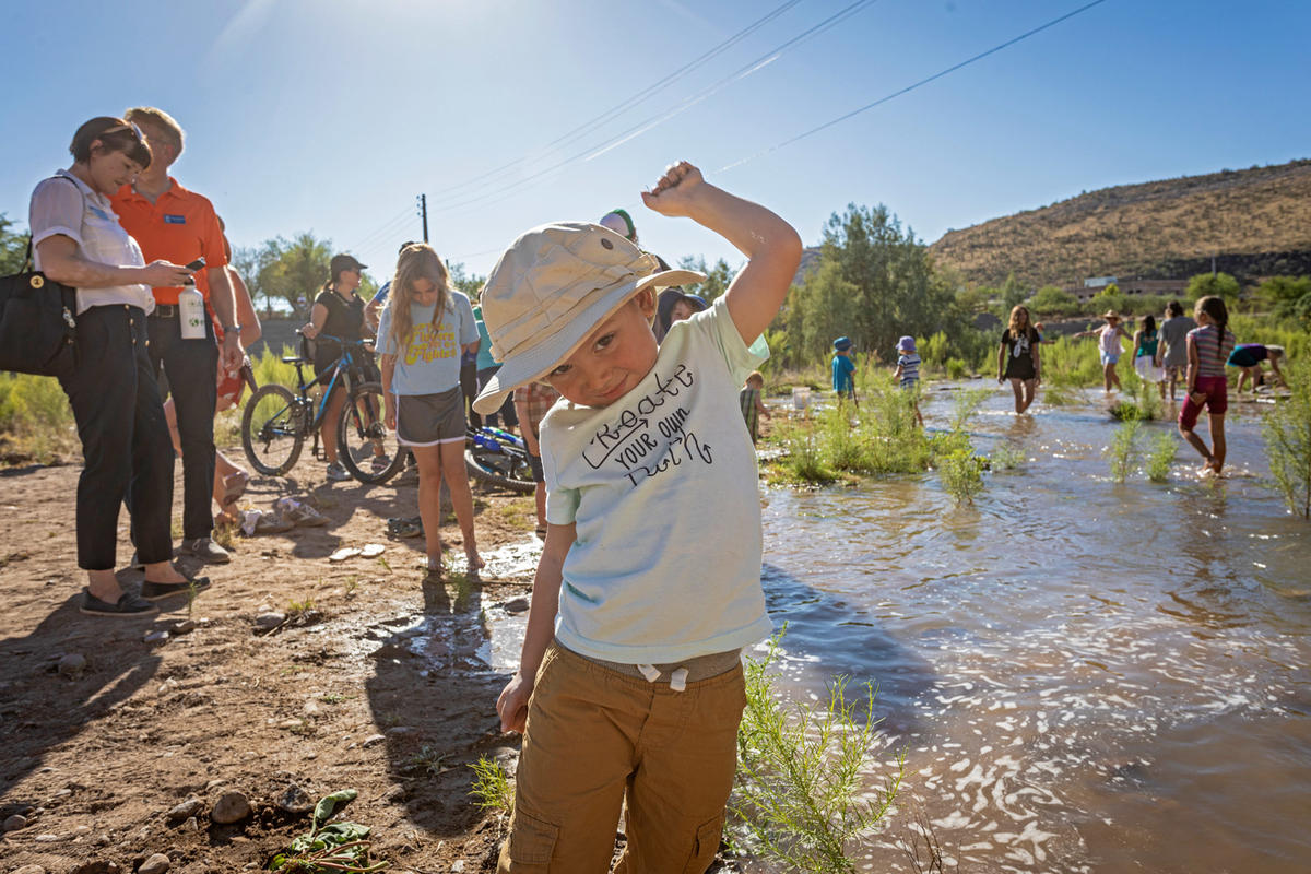 Child by the outflow water of the Santa Cruz River Heritage Project