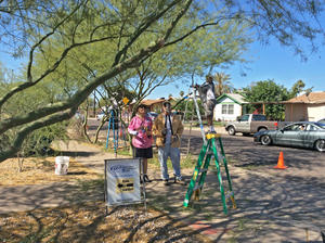 Volunteers help at a rain garden and tree pruning workshop at Primera Iglesia near downtown Phoenix, 2015.