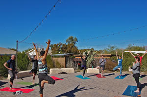 Yoga tree pose at the Living Lab courtyard