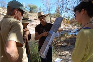 WMG's Policy & Technical Director Catlow Shipek, center, along with WMG's River Restoration Biologist Trevor Hare (far left), Van Clothier with Stream Dynamics and a volunteer (right) are reviewing opportunities and strategies to restore lower Sabino Creek.