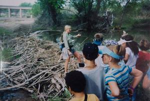 Sandy Anderson, director of Gray Hawk Nature Center, shows school kids a beaver dam on the San Pedro River in 2004. Courtesy of Sandy Anderson