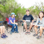 WMG friends relaxing in their camping chairs.