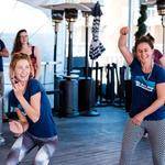 WMG's Sarah Brown, Deborah Oslik and Lisa Shipek, mid-dance-move