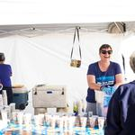 Drinks galore! Board member, Jennifer Psillas serves Exo Toddy, orange juice, and iced tea.