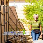 Volunteer Judy van Naerssan, teaches kids to plant desert-adapted seeds.