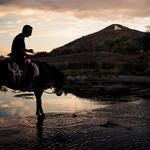 Horse and human enjoy the Santa Cruz River at dusk. Photo by Julius Schlosburg