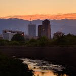 The Santa Cruz and downtown Tucson at dusk. Photo by Julius Schlosburg