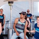 WMG's Lisa Shipek, Rudy Poe, and Deborah Oslik showing off their dance moves
