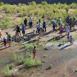 Tucsonans wade in the Santa Cruz River's new waters. Photo by Jamie Manser