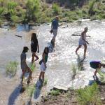 Tucsonans wade in the Santa Cruz River's new waters. Photo by Jamie Manser
