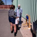 "Jean Fedigan, executive director of the Sister Jose Women's Shelter located at 1050 S. Park Ave., shows the ""Tippy tap"" hand wash station to a woman."