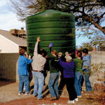 Co-op group moving a cistern.