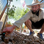 Local resident checks his greywater system. Photo by Mike Christy, Arizona Daily Star