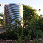 Waterharvesting cistern and earthworks at a Tucson home.