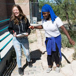 Riley Fletcher and her classmate Madina Omar, right, will use their temperature data to assess the changes in the low-water adapted garden.