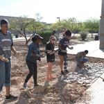 Cienega High School water harvesting project - volunteer students doing rockwork