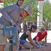 Students constructing schoolyard rain garden